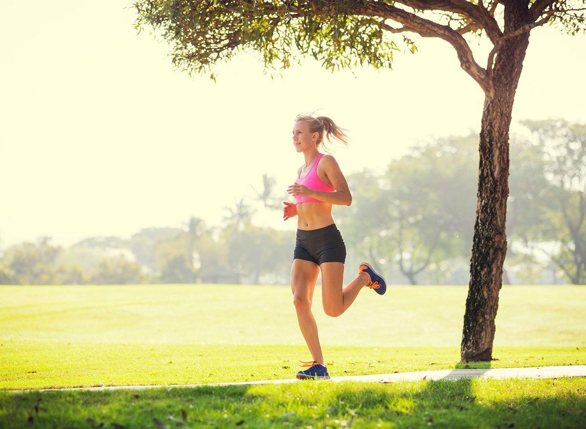 photodune-6706914-young-woman-jogging-running-outdoors-m